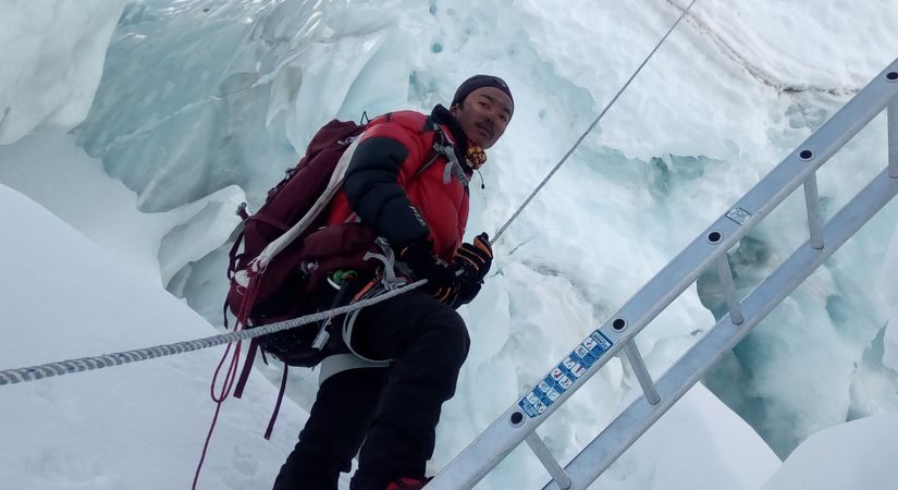 Climbing in Ladder to conquer world' highest Peak
