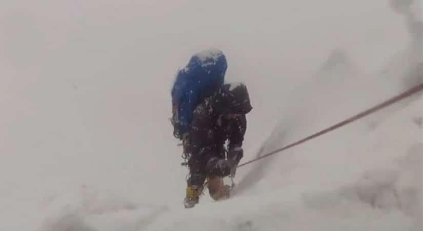 Climbing Thamserku while snow-falling
